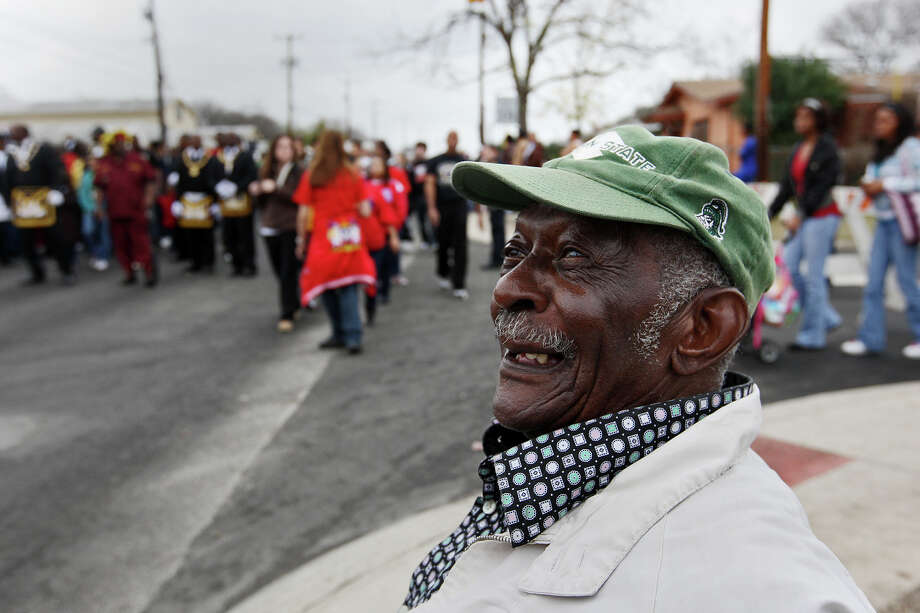 Sitting at the corner of Amanda Avenue and Martin Luther King Drive, John Washington, 84, watches the City of San Antonio Martin Luther King, Jr., 25th anniversary Commemorative March, Monday, Jan. 16, 2012. Washington, who lives a block away, has watched the march at that corner since its inception. Photo: JERRY LARA, San Antonio Express-News / SAN ANTONIO EXPRESS-NEWS