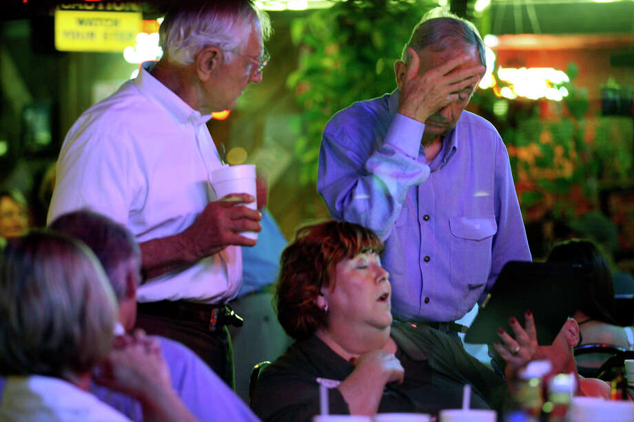 Texas Sen. Jeff Wentworth, right, holds his forehead while waiting for final results at Chester's Hamburgers on election night, Tuesday, May 29, 2012. Wentworth went on to a runoff election with physician Donna Campbell and lost. Photo: Jerry Lara, San Antonio Express-News / © San Antonio Express-News
