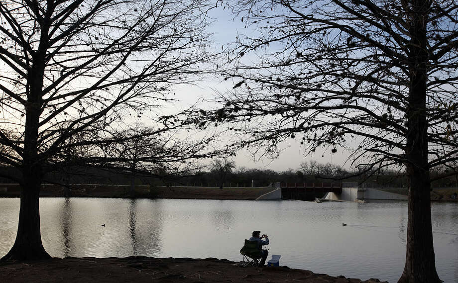 Billy Marek takes advantages of a near perfect morning to fish at South Side Lions Park, Monday, Jan. 23, 2012. Photo: Jerry Lara, San Antonio Express-News / © 2012 San Antonio Express-News