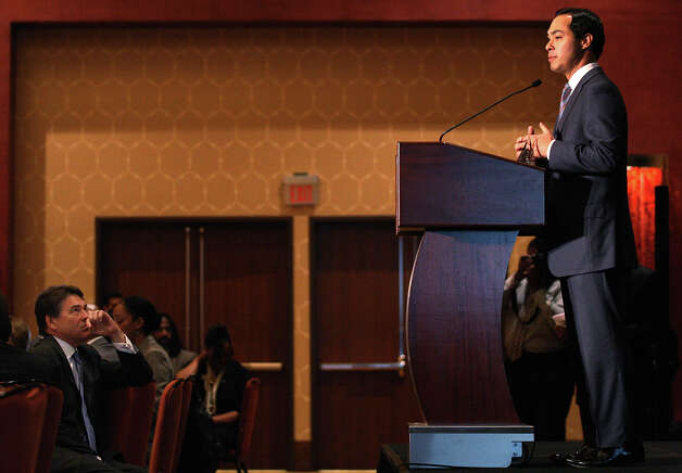 After being honored, San Antonio Mayor Julian Castro addresses the United Negro College Fund South Texas Governor's Luncheon at the Grand Hyatt, Thursday, Oct. 25, 2012. The event is a fundraiser for UNCF. The Governor's Luncheon in Dallas last September raised over $185,000. Seated on the left is Texas Governor Rick Perry. Photo: Jerry Lara, San Antonio Express-News / © 2012 San Antonio Express-News
