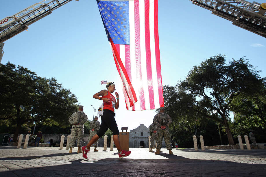 Minda Tovar runs by the Alamo on her way to finish the Stephen Siller Tunnel to Towers Run San Antonio 5K at Alamo Plaza, Sunday, Sept. 9, 2012. Photo: Jerry Lara, San Antonio Express-News / © 2012 San Antonio Express-News
