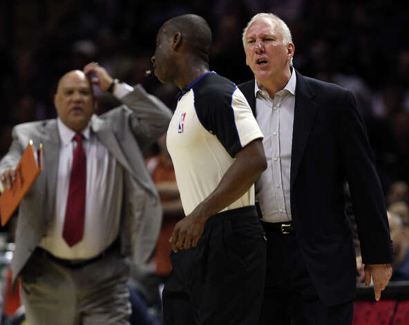San Antonio Spurs Head Coach Gregg Popovich argues a call with official James Williams before he is ejected during the second half against the New York Knicks at the AT&T Center, Wednesday, March 7, 2012. The Spurs won 118-105. In back is Assistant Coach Don Newman. Photo: Jerry Lara, San Antonio Express-News / © San Antonio Express-News