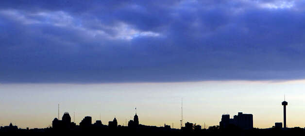 A line of clouds moves over downtown San Antonio early Friday morning June 1, 2012. The weekend forecast calls for partly cloudy skies with highs in the lower 90s. Photo: John Davenport, San Antonio Express-News