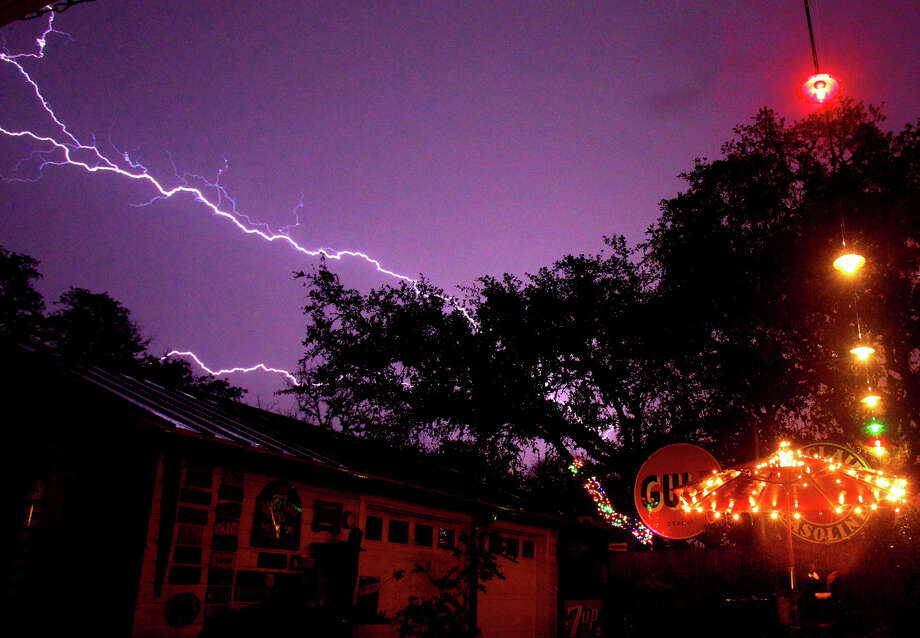 Lightning streaks across the sky in north central San Antonio as a line of thunderstorms moves through the Hill Country area early Wednesday morning January 25, 2012. Photo: John Davenport, San Antonio Express-News / SAN ANTONIO EXPRESS-NEWS (Photo can be sold to the public)