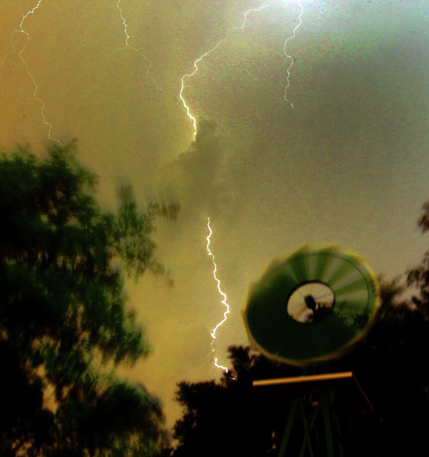Lightning flashes in north San Antonio as storms move into the area Monday May 7, 2012. Photo: John Davenport, San Antonio Express-News