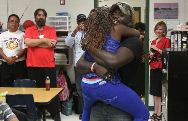 "United States Marine Corps Staff Sergeant Tresor Bunker (right) is reunited with his nine-year-old sister Shasha Ogork at Steubing Elementary School Wednesday October 17, 2012 after returning home from Afghanistan. Bunker, a 10-year veteran of the Marine Corps, made the surprise homecoming after his fifth tour of duty. Ogork is a fourth grader at Steubing. ""It's the greatest feeling in the world to come home,"" Bunker said. Photo: John Davenport, San Antonio Express-News"