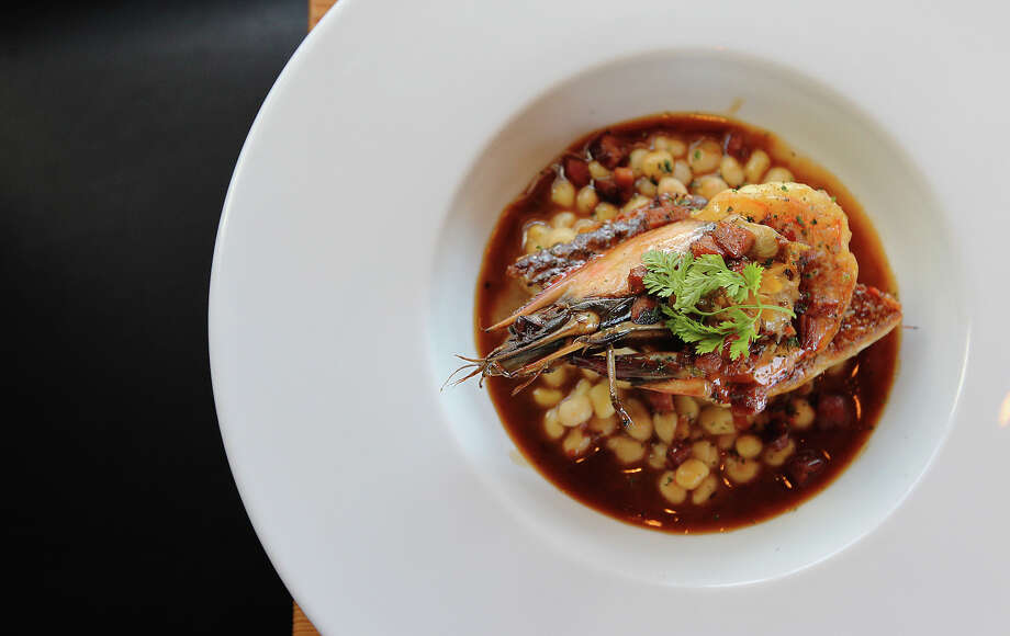 Taste review of Bliss on Wednesday, Apr. 4, 2012. Pictured is an entree of redfish and prawn. Photo: Kin Man Hui, San Antonio Express-News / ©2012 San Antonio Express-News