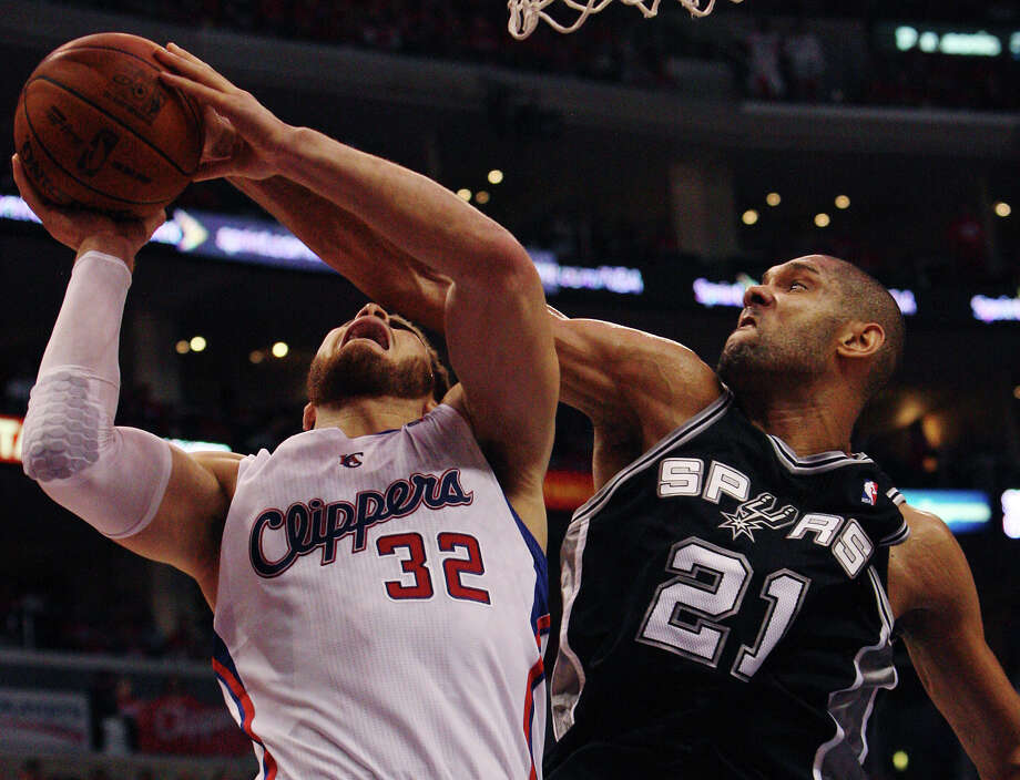 Spurs' Tim Duncan (21) blocks a shot against the Los Angeles Clippers' Blake Griffin (32) in the second half of game three of the Western Conference semifinals at the Staples Center in Los Angeles on Saturday, May 19, 2012. The Spurs won 96-86. Photo: Kin Man Hui, San Antonio Express-News / San Antonio Express-News
