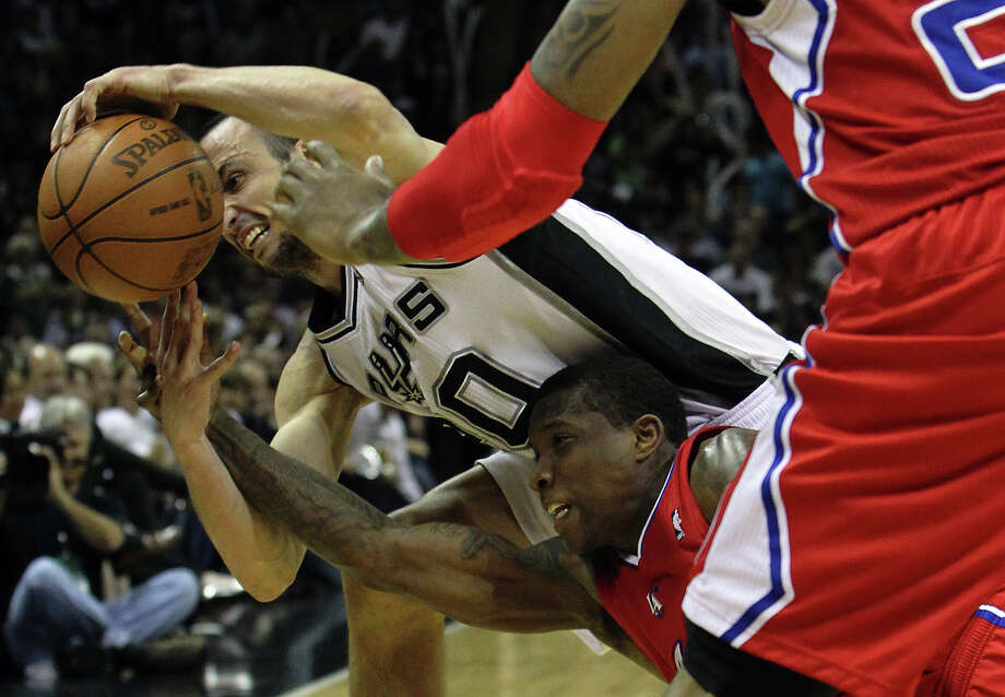 Spurs' Manu Ginobili (20) and Los Angeles Clippers' Eric Bledsoe (12) contend for a loose ball in the second half of Game 1 of the Western Conference semi-finals at the AT&T Center on Tuesday, May 15, 2012. Spurs defeated the Clippers, 108-92. Photo: Kin Man Hui, San Antonio Express-News / San Antonio Express-News