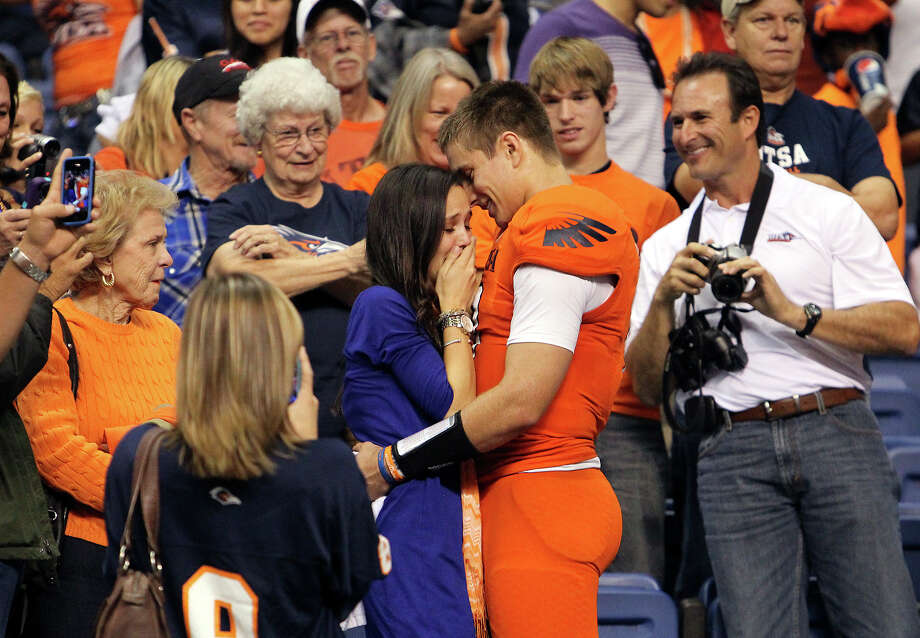 UTSA quarterback Eric Soza (right) proposes to his girlfriend Audrey Jones after the game against Texas State at the Alamodome on Saturday, Nov. 24, 2012. The Roadrunners defeated the Bobcats 38-31. Jones accepted according to family friends. Photo: Kin Man Hui, San Antonio Express-News / © 2012 San Antonio Express-News