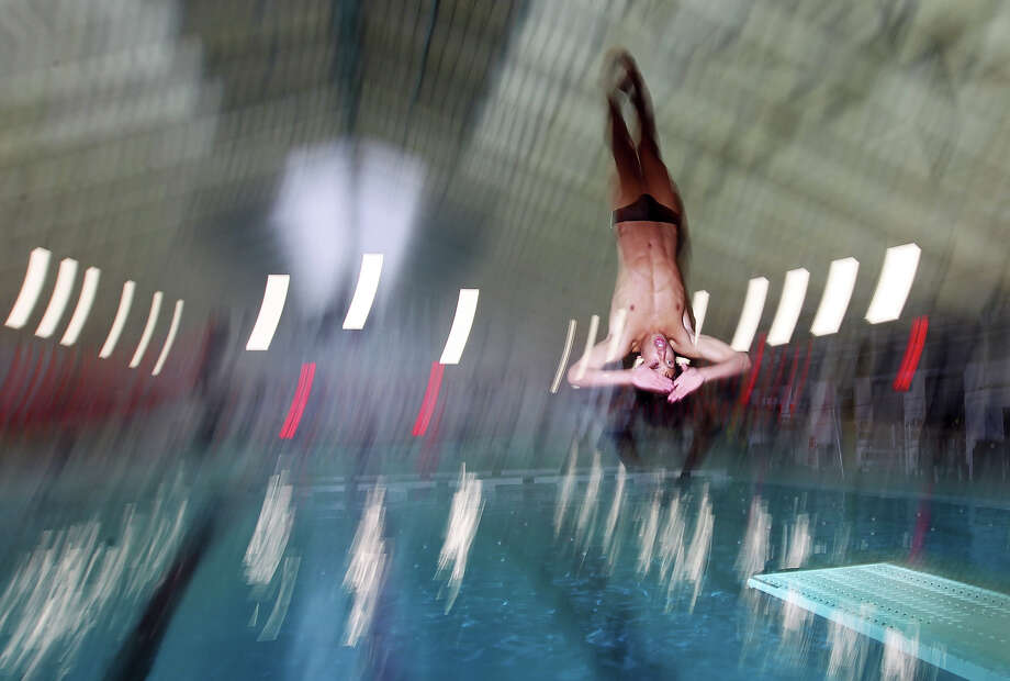 Marshall High School freshman Christopher Law is considered the top diver in the area and will likely medal at state. Law was practicing at Block Natatorium on Wednesday, Jan. 25, 2012. Photo: Kin Man Hui, San Antonio Express-News / San Antonio Express-News