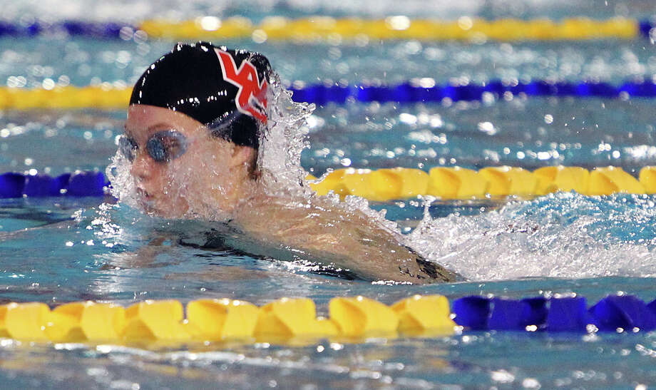 Churchill's Hannah Arnold swims the breastroke portion of the 200 yard medley relay to help her team win at the District 26-5A swim meet at Davis Natatorium on Saturday, Feb. 4, 2012. Photo: Kin Man Hui, San Antonio Express-News / San Antonio Express-News