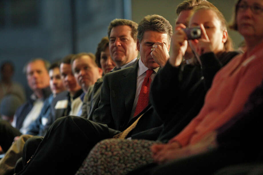 Republican presidential candidate Governor Rick Perry takes a moment to himself as Louisiana Governor Bobby Jindal speaks and introduces him at a campaign event at Nationwide in Des Moines onTuesday, Jan. 3, 2012. Photo: LISA KRANTZ, San Antonio Express-News / SAN ANTONIO EXPRESS-NEWS