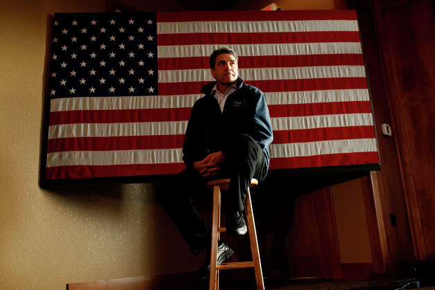 Republican presidential candidate Governor Rick Perry waits offstage to speak while Marcus Luttrell introduces him at the Santa Maria Winery in Carroll, IA, on Monday, Jan. 2, 2012. Luttrell is a former Petty Officer First Class and United States Navy SEAL who received the Navy Cross for his actions in 2005 in Afghanistan and he campaigned with Perry on Monday. Photo: LISA KRANTZ, San Antonio Express-News / SAN ANTONIO EXPRESS-NEWS