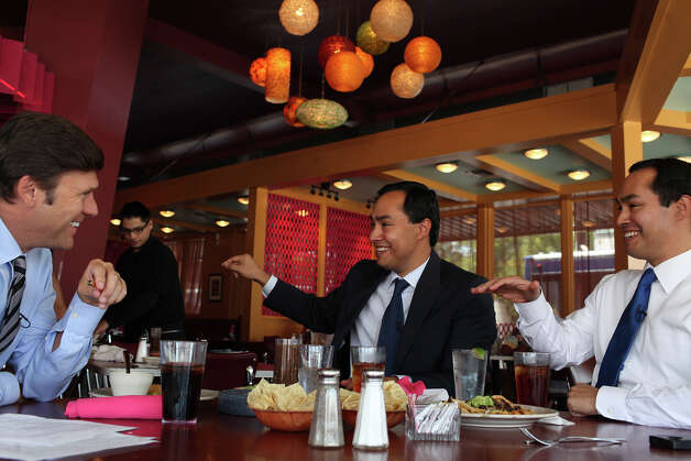 Mayor Julian Castro, right, and his brother, Congressional candidate Joaquin Castro, center, are interviewed by CBS News National Correspondent Lee Cowan, left, as they tape a segment for the CBS Evening News at Rosario's in San Antonio on Friday, August 24, 2012. The segment will air the night Castro gives the keynote speech at the Democratic National Convention. Photo: Lisa Krantz, San Antonio Express-News / San Antonio Express-News