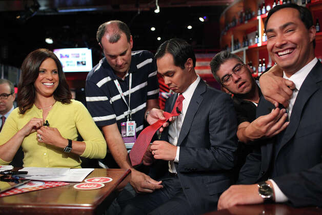Mayor Julian Castro, center, and his brother, Joaquin Castro, right, get ready to appear on CNN's morning news program Starting Point with anchor Soledad O'Brien, left, at the CNN Grill during the Democratic National Convention in Charlotte, NC on Wednesday, Sept. 5, 2012. Photo: Lisa Krantz, San Antonio Express-News / San Antonio Express-News