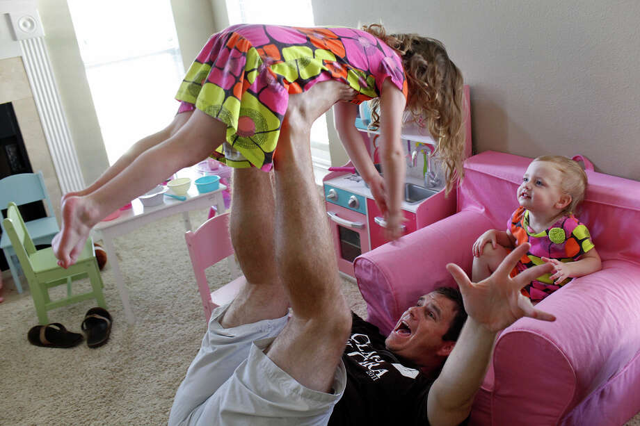 Justin Hobbs plays with his daughters, Hailey, 4, and Kate, 2, at their home in Fair Oaks Ranch on Saturday, June 9, 2012. Photo: Lisa Krantz, San Antonio Express-News / 2012 San Antonio Express-News