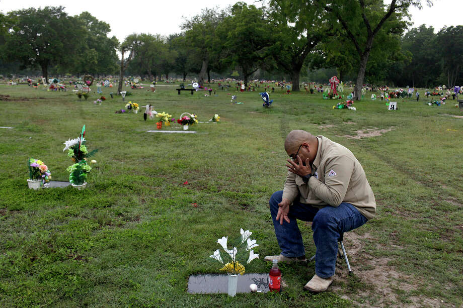 John Garcez visits the grave of his brother-in-law and best friend, Juan Urrutia, who was killed when Jacob Perez, who was drunk and driving the wrong way on U.S. 90, hit their car, which Garcez was driving and Urrutia was a passenger in, in San Antonio on May 19, 2012. Garcez visits Urrutia's grave at least once a week, bringing Urrutia's favorite drink, Big Red, and a baseball or football, for their shared love of sports. Photo: Lisa Krantz, San Antonio Express-News / San Antonio Express-News