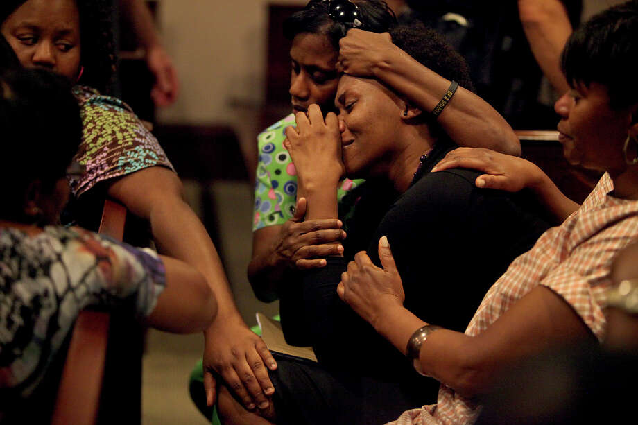 La Tonya Ranson-Archer, center, the Godmother of Antwan Wolford, cries tears of relief with her sisters Theresa Walker, left, and Brenda Westbrooks, right, all cousins of Wolford, after Tiffany James was found guilty of manslaughter in her trial for the death of Wolford in the Bexar County 399th District Court on Thursday, July 26, 2012. Photo: Lisa Krantz, San Antonio Express-News / San Antonio Express-News