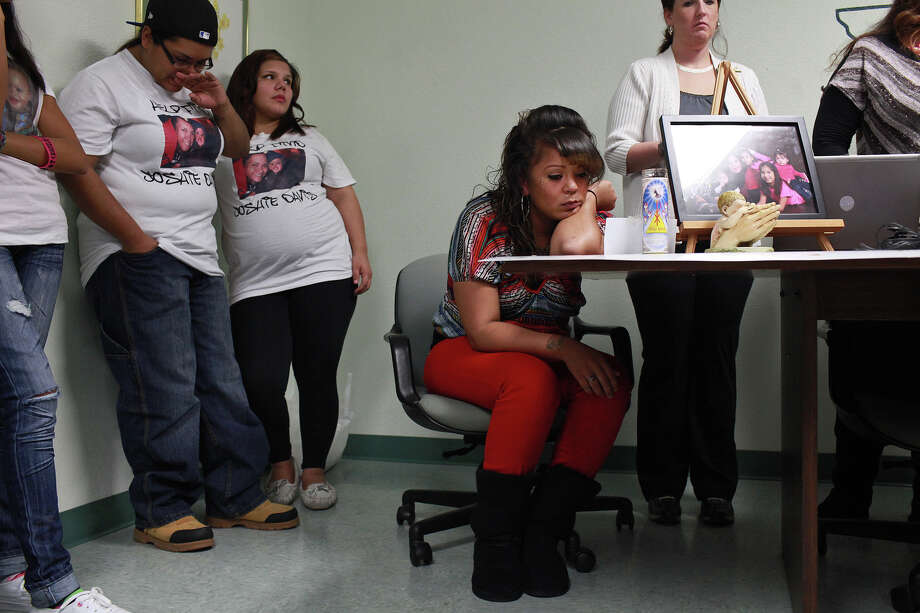 Sabrina Benitez, center, the mother of Joshua Davis Jr., sits as her mother, far right, talks about Benitez's son, Joshua Davis Jr., on the one-year anniversary of his disappearance in New Braunfels, at the Heidi Search Center in San Antonio on Saturday, Feb. 4, 2012. From left, is Davis' Godmother Estella Garcia, and Marissa Armendariz and at right is Alisa Reynolds, funding coordinator for the Heidi Search Center. Photo: Lisa Krantz, San Antonio Express-News / @2012 SAN ANTONIO EXPRESS-NEWS