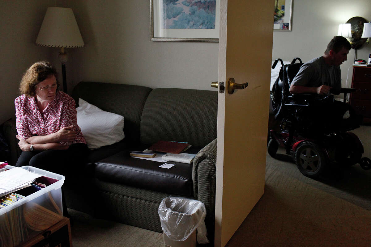 Saralee Trimble and her son, Army Pfc. Kevin Trimble, 19, meet for lunch in their two room hotel room at the Powless Guest House at Fort Sam Houston in San Antonio on Wednesday, March 7, 2012.