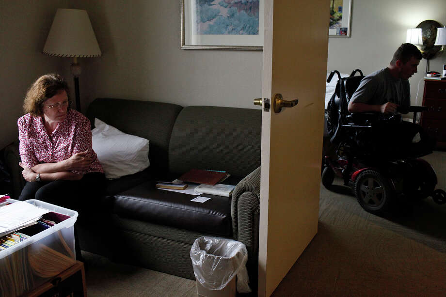 Saralee Trimble and her son, Army Pfc. Kevin Trimble, 19, meet for lunch in their two room hotel room at the Powless Guest House at Fort Sam Houston in San Antonio on Wednesday, March 7, 2012. Photo: Lisa Krantz, San Antonio Express-News / @San Antonio Express-News