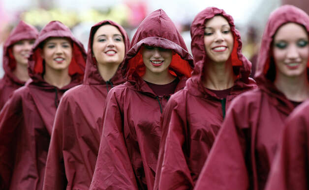 The Strutters had to wear raincoats for the pregame asTexas State hosts Nevada at Bobcat Stadium on September 29, 2012. Photo: Tom Reel, San Antonio Express-News / ©2012 San Antono Express-News