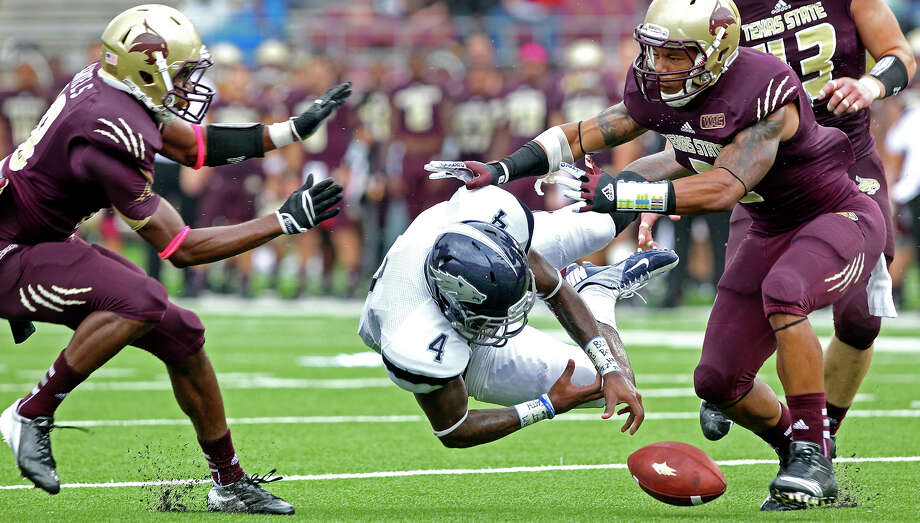 Bobcat defensive backs Xavier Daniels (left) and Darryl Morris make sure Brandon Wimberly drops away from a pass as Texas State hosts Nevada at Bobcat Stadium on September 29, 2012. Click to browse all of the EN's most memorable photos of 2012  Photo: Tom Reel, San Antonio Express-News / ©2012 San Antono Express-News