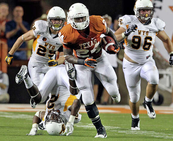 Longhorn running back Joe Bergeron breaks through on  64 yard rush from deep in his own territory as Texas hosts Wyoming at D.K.Royal Stadium in Austin on September 1, 2012. Photo: Tom Reel, San Antonio Express-News / ©2012 San Antono Express-News