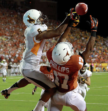 Longhorn defender Adrian PhilipsTbreaks up a pass to Robert Herron in the fourth quarter as Texas hosts Wyoming at D.K.Royal Stadium in Austin on September 1, 2012. Photo: Tom Reel, San Antonio Express-News / ©2012 San Antono Express-News