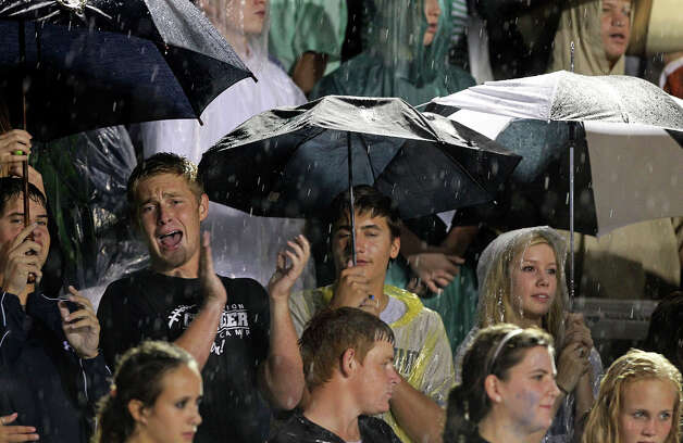 Chargers fans make the best of it in the rain as Boerne Champion hosts Alamo Heights at Boerne Stadium on September 28, 2012. Photo: Tom Reel, San Antonio Express-News / ©2012 San Antono Express-News