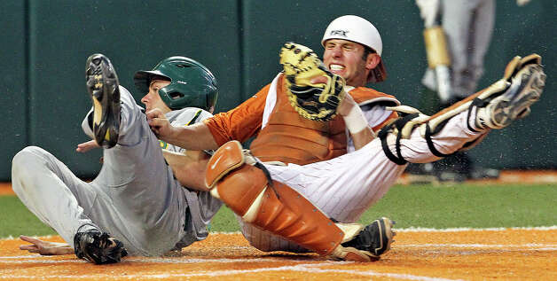 Longhorn catcher Jacob Felts spins on the ground after a collision to get the put out of Cal Towey to end the top of the 7th as Texas plays Baylor at Disch-Falk Field in Austin on May 18, 2012. Photo: TOM REEL, San Antonio Express-News / San Antonio Express-News
