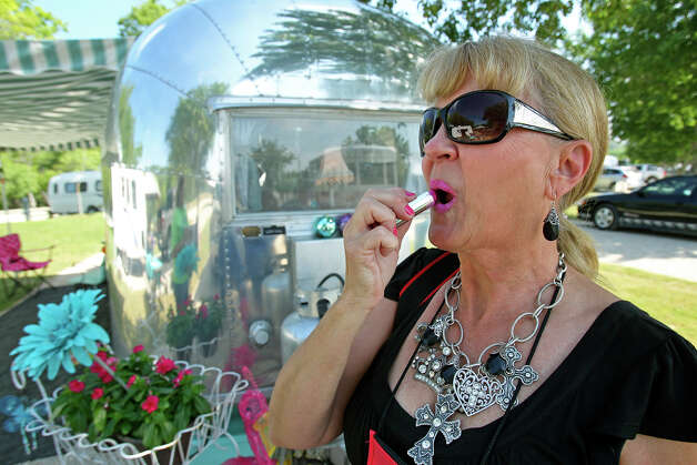 Pam Sinclair keeps her lipstick fresh as the Get'Away Gals camp at the Lazy L&L Campground on April 25, 2012. Photo: TOM REEL, San Antonio Express-News / TREEL@EXPRESS-NEWS.NET