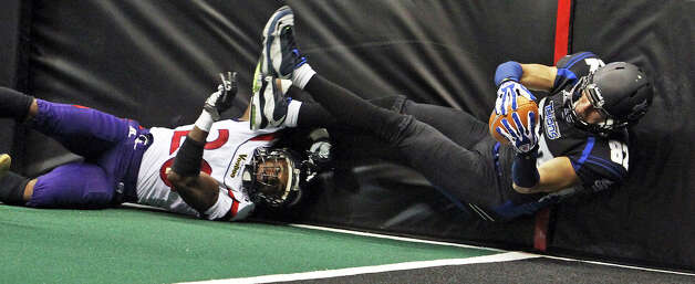 Talons receiver Robert Quiroga stretches into the end zone after beating Jeremy Kellem on a pass to the left side as the San antonio Talons host the New Orleans Voodoo at the Alamodome on April 13, 2012. Photo: TOM REEL, San Antonio Express-News / San Antonio Express-News