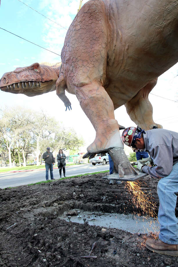 Gilbert Rodriguez welds some mounting brackets in place after a life-size Acrocanthosaurus is transported from the Henry B. Gonzalez Covention Center to the Witte Museum on February 24, 2012. Photo: TOM REEL, San Antonio Express-News / TREEL@EXPRESS-NEWS.NET