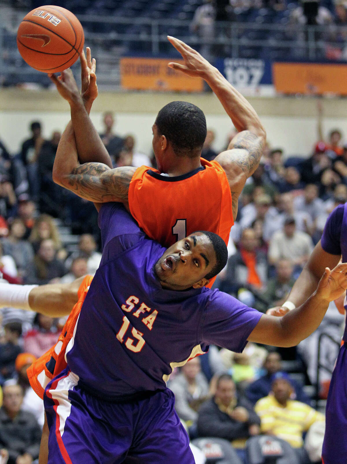 SFA's Joe Bright moves under the rebounding effort of Stephen Franklin and is called for a position foul as the Roadrunners play the SFA Lumberjacks at the UTSA Convocation Center on February 11, 2012.