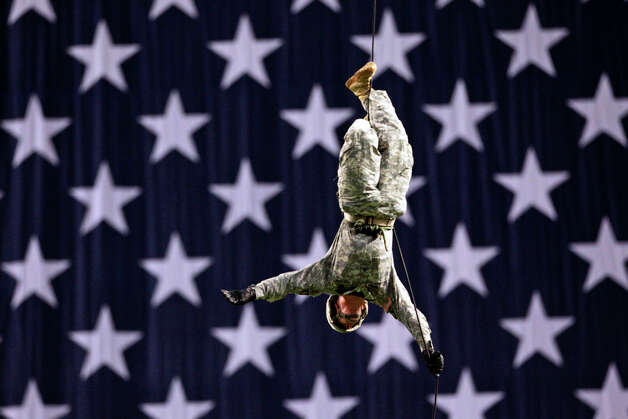 A soldier repels in to start the game at the 2012 U.S. Army All-American Bowl at the Alamodome on January 7, 2012. Photo: TOM REEL, San Antonio Express-News / © 2011 San Antonio Express-News MAGS OUT; TV OUT; NO SALES; SAN ANTONIO OUT; AP MEMBERS ONLY; MANDATORY CREDIT; EFE OUT
