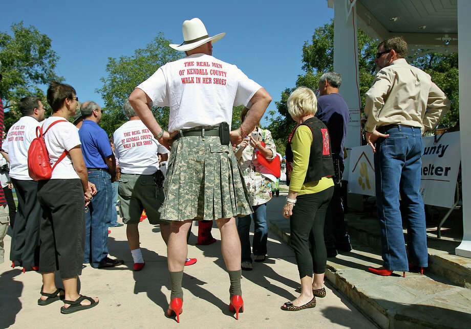 """Don Pryor, Major U.S. Army (Ret.) listens to proceedings before the Men of Kendall County participate in """"Walk a Mile in Her Shoes"""" to benefit the Kendall County Women's Shelter in downtown Boerne on October 3, 2012.Click to browse all of the EN's most memorable photos of 2012  Photo: Tom Reel, San Antonio Express-News / ©2012 San Antono Express-News"""