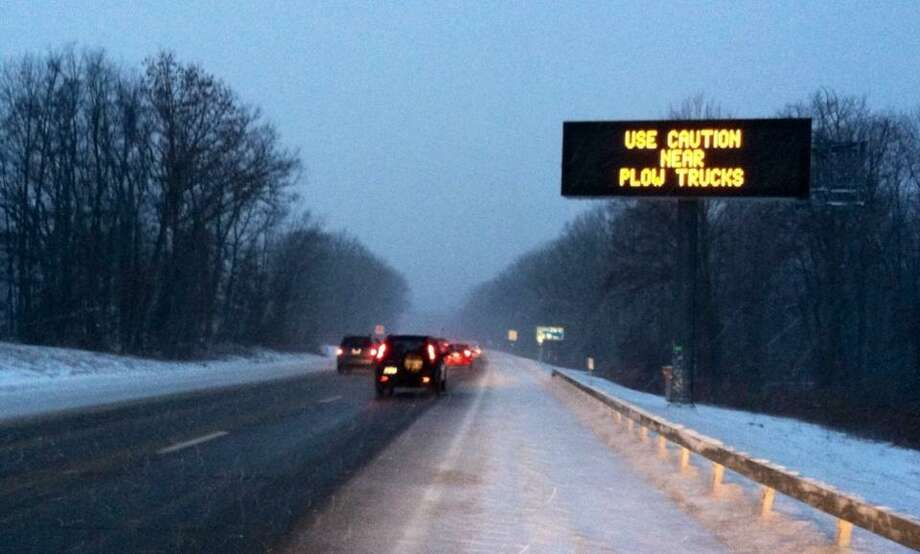 A caution sign tells motorists something that they probably already know: Caution is best on a snowy commute. (SKIP DICKSTEIN / TIMES UNION)