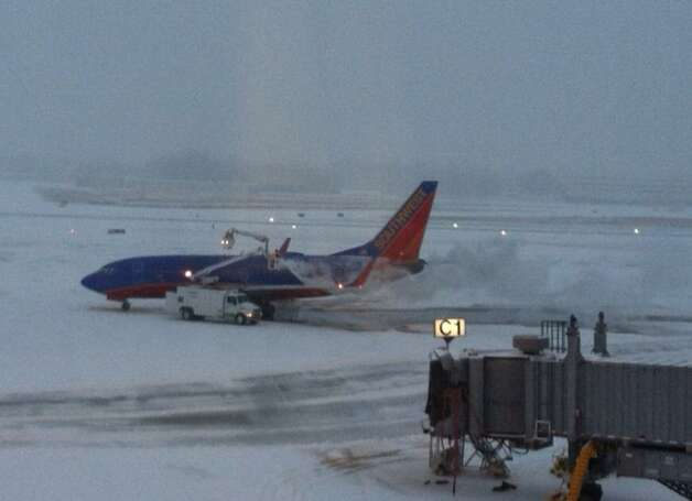 The 6:30 a.m. Southwest Airline flight to Chicago Midway was still being de-iced at 7:59 a.m. at Albany International Airport on Thursday, Dec. 27, 2012. (SKIP DICKSTEIN / TIMES UNION)