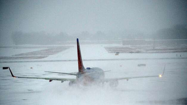Southwest flight to Chicago Midway finally gets off the ramp and on its way 1 1/2 hours late this morning due to the inclement weather both her in Colonie, N.Y. and in the Chicago area Dec 27, 2012. (Skip Dickstein/Times Union) Photo: SKIP DICKSTEIN
