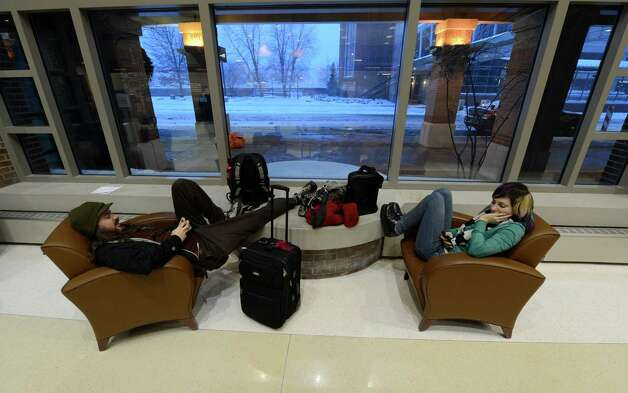 Justin Romito and Sarah Daus have been stranded for more than 48 hours at the Albany International Airport in  Colonie, N.Y. trying to return to their home in Portland, Ore., on Dec. 27, 2012. (Skip Dickstein/Times Union) Photo: SKIP DICKSTEIN