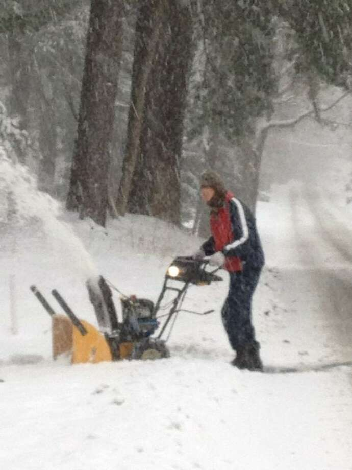 A man and his snowblower clear powder on Lone Pine Road in Guilderland after a storm Thursday, Dec. 27, 2012 dumped heavy snow on the Capital Region. (PAUL GRONDAHL / TIMES UNION)
