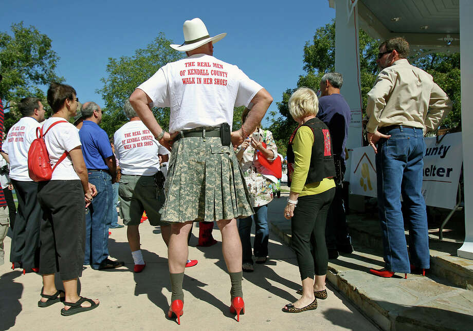Retired U.S. Army Maj. Don Pryor was both statuesque and picturesque after donning a skirt and red ladies' heels for the Walk a Mile in Her Shoes benefit in downtown Boerne in October. Photo: Tom Reel, San Antonio Express-News / ©2012 San Antono Express-News