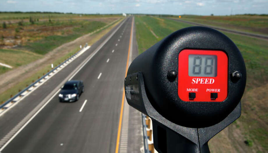 A car is unofficially clocked going 88 mph Wednesday afternoon Oct. 24, 2012 on the southern extension of Texas 130 from Seguin to Austin on the toll road's opening day. The road has the highest speed limit--85 mph--of any road in the country. Photo: William Luther / © 2012 San Antonio Express-News