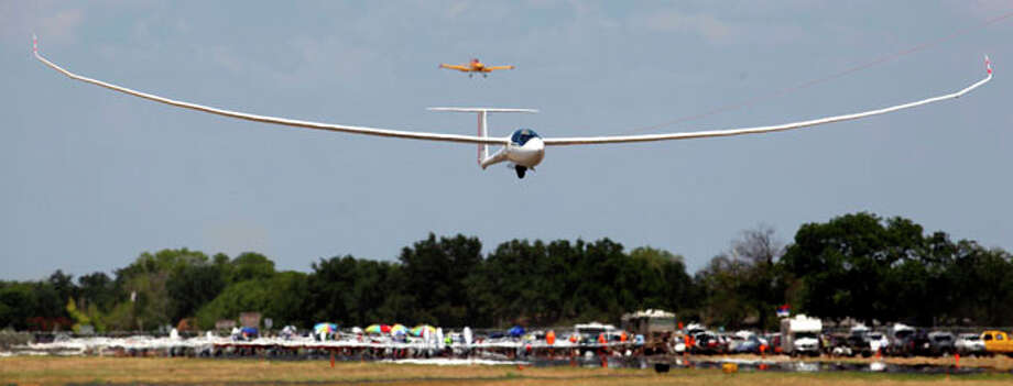 An open class glider takes off Wednesday Aug. 8, 2012 from Garner Field airport in Uvalde as it starts Day 4 of competition at the 32nd FAI World Gliding Championship. Open class gliders are not restricted in their design and are most noted for their extremely long, slender wings. Photo: William Luther / © 2012 San Antonio Express-News