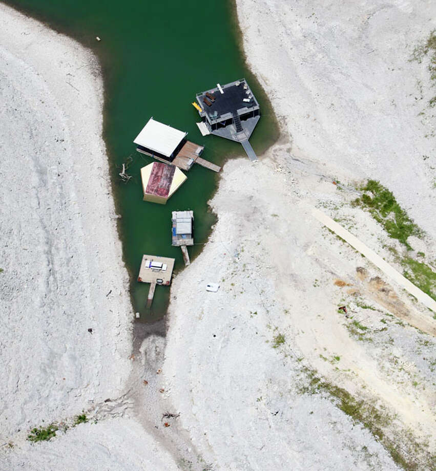 Boat docks on Medina Lake squeeze into an ever-shrinking cove in this Wednesday Aug. 1, 2012 aerial image. The Texas Water Development Board's website reports the lake is 59.39 feet low and is currently only 16.22 percent full Photo: William Luther / © 2012 San Antonio Express-News