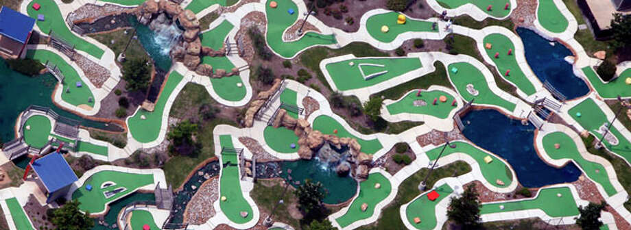 The greens of The Ice & Golf Center at Northwoods are seen in this April 10, 2012 aerial photo. Two 18-hole courses with 5 ponds, two waterfalls, and several water hazards grace the facility in the southeast corner of the U.S. 281 and Loop 1604 intersection. Photo: William Luther / © 2012 WILLIAM LUTHER