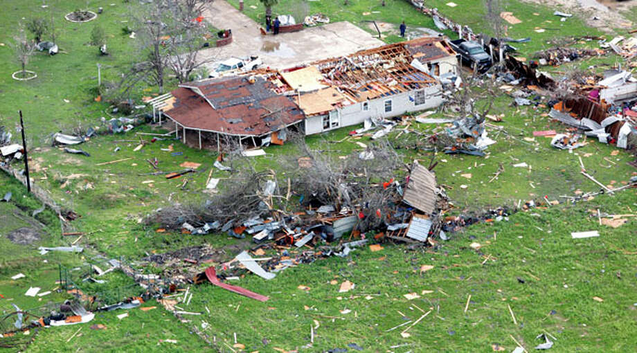 Damage from an overnight tornado in the Devine area is seen in this Tuesday March 20, 2012 aerial image. Photo: William Luther / © 2012 WILLIAM LUTHER
