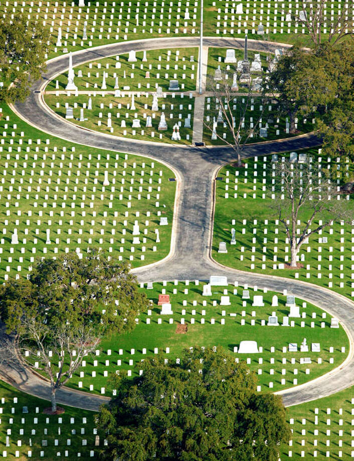 San Antonio National Cemetery, at 517 Paso Hondo St. on San Antonio's near-East Side, is seen in a Thursday Feb. 2, 2012 aerial photo. The cemetery, according to the Veterans Administration website, was established in 1867 and includes the remains of 16 Medal of Honor recipients, 281 Buffalo soldiers. Additonally 2nd Lt. George M. Kelly, for whom Kelly AFB was named, and Brig. Gen. John L. Bullis, for whom Camp Bullis was named, are also buried there among numerous other notable early San Antonio residents. Photo: William Luther / © 2012 SAN ANTONIO EXPRESS-NEWS